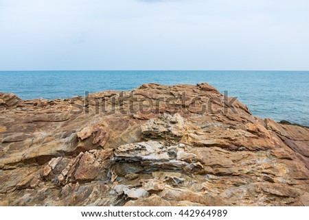 Tranquil scene of cliff with seascape view at Khao Laem Ya, Mu Ko Samet National Park in Thailand. - stock photo