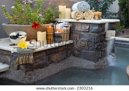 tranquil scene of resort style spa with aroma therapy objects - stock photo