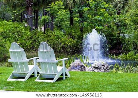 Tranquil scene with fountain and chairs
