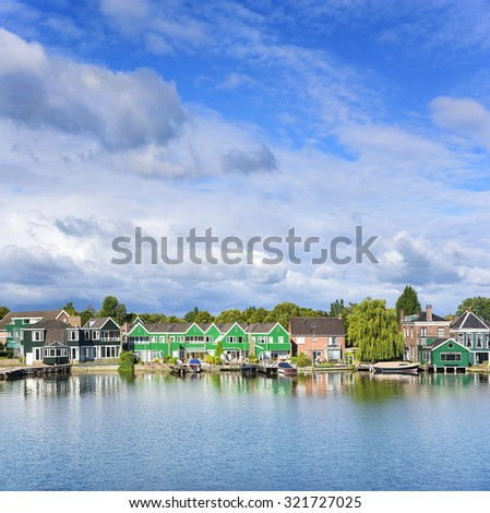 Tranquil scene. Zaanse Schans. Picturesque view of a Dutch village located at the river. - stock photo