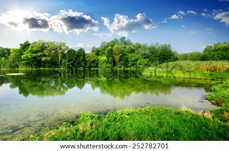 Tranquil summer day on a quiet river - stock photo