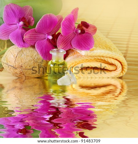 Tranquil sunny light Spa arrangement with essential oil and violet orchids - water reflection