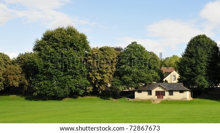 Tranquil Village Green Scene - stock photo