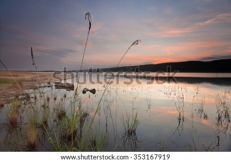Tranquil waters and just the sound of birds and frogs and splashes from fish jumping at Lake Burralow - stock photo