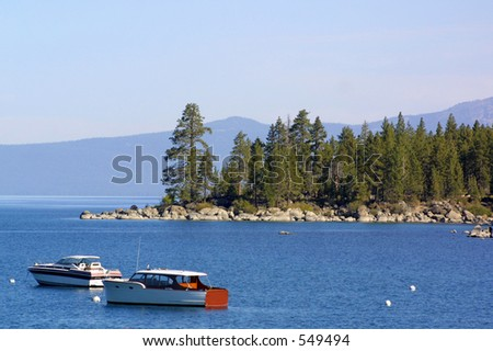 tranquility of the boats moored in the cove on Lake Tahoe - stock photo