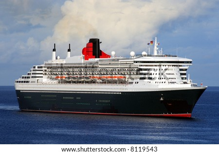 Trans Atlantic ocean liner entering port - stock photo