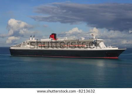 Trans Atlantic ocean liner entering port - stock photo