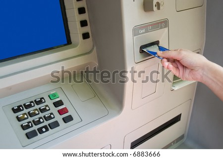 Transaction at an ATM - stock photo
