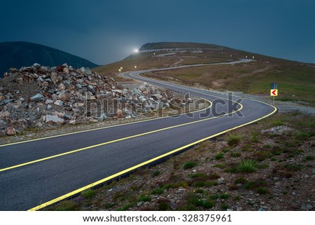 Transalpina road at dusk, highest and most dangerous asphalt road in Romania. - stock photo