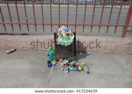 Transcarpathia, Ukraine - May 2, 2016: Trash full of garbage - stock photo