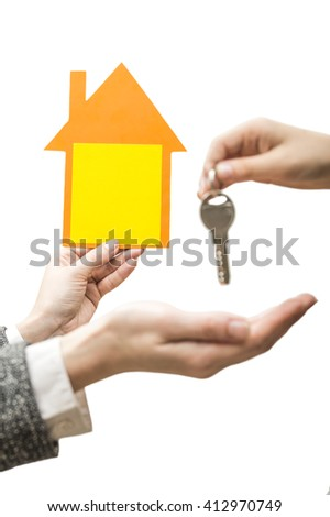 Transfer key from hand to hand - stock photo