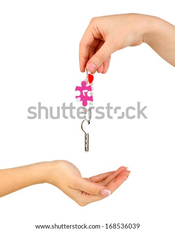 Transfer of house keys isolated on white - stock photo