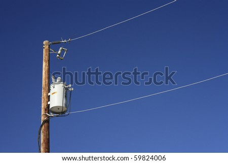 Transformer and power lines on a wooden post. - stock photo