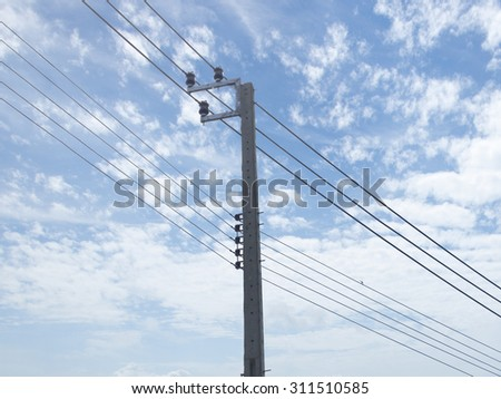Transformer and power lines on electric pole, High voltage power pole with wires tangle. - stock photo