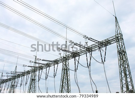 transformer isolator station and cloudy sky - stock photo
