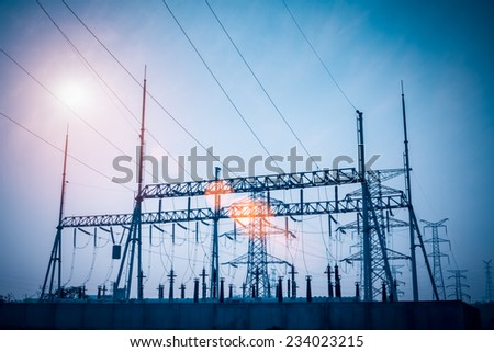 transformer substation silhouetted against dusk sky , electricity background  - stock photo