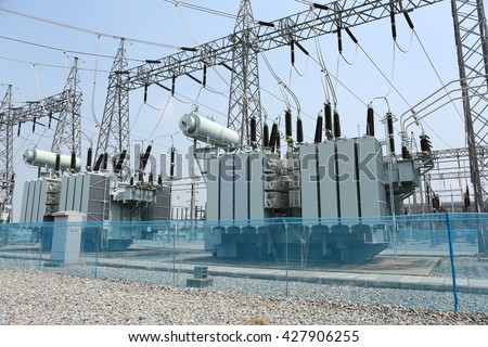 Transformer : The equipment used to raise or lower voltage, high voltage power station - stock photo