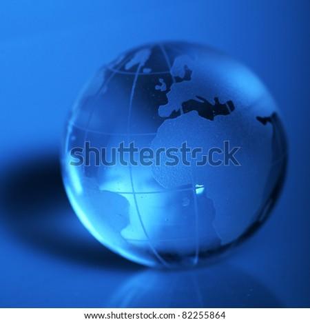 Translucent globe with blue background - stock photo