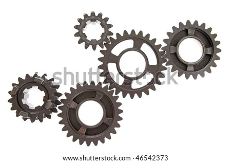 Transmission gears linked together on white background. - stock photo