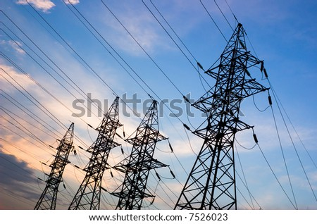 Transmission line on a background of the coming sun - stock photo