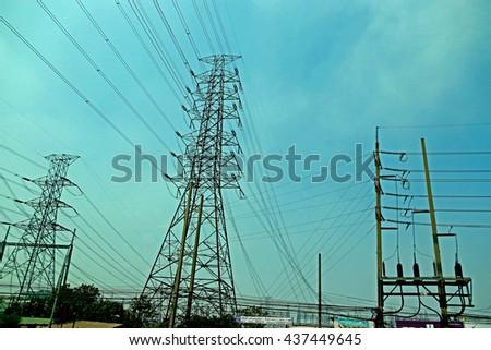 Transmission line tower on blue sky - stock photo