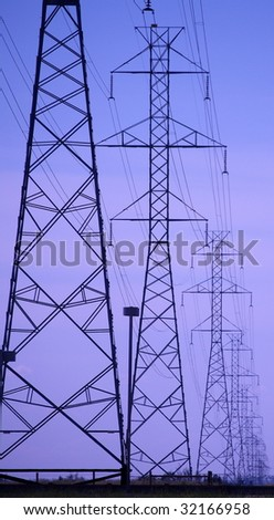 Transmission lines against a blue Alberta sky - stock photo