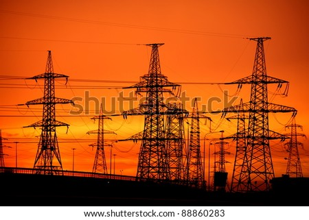 transmission power line on sunset - stock photo