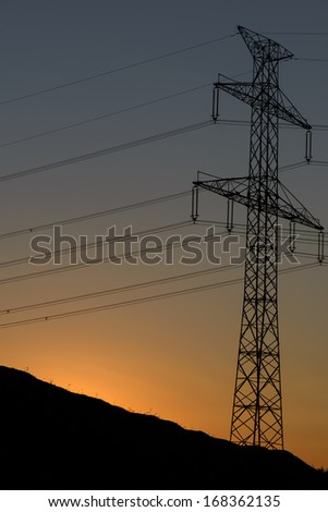 Transmission Tower At Sunset