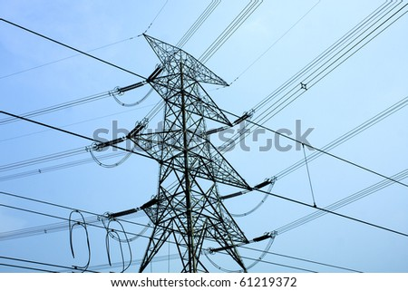 transmission tower with blue toned at day