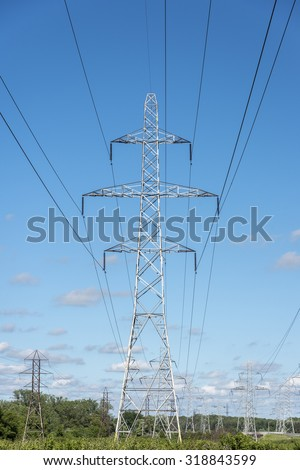 Transmission towers deliver electricity along the lines in Niagara Ontario Canada. - stock photo
