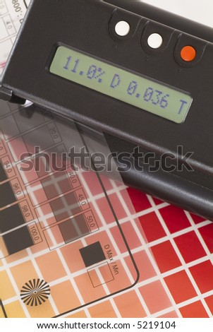 Transmissiondensitometer with halftone control strip and ColorChecker. - stock photo