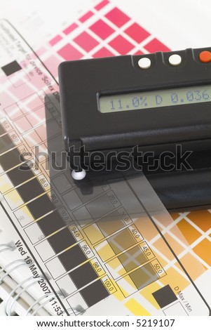 Transmissionsdensitometer with halftone control strip and ColorChecker. - stock photo