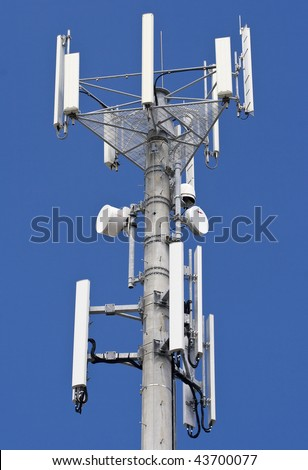 Transmitter over blue sky for mobile connection - stock photo