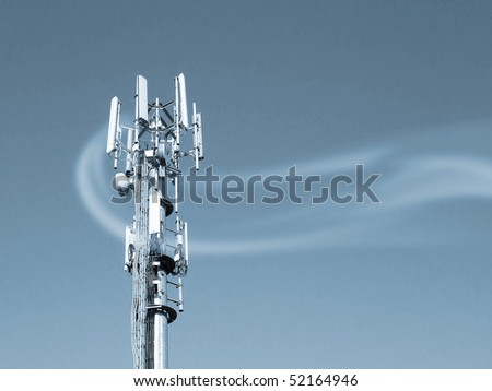Transmitter tower overlaid with smoke pattern. Blue toned. - stock photo