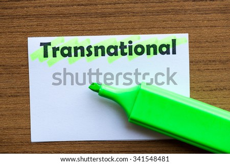 transnational word highlighted on the white paper