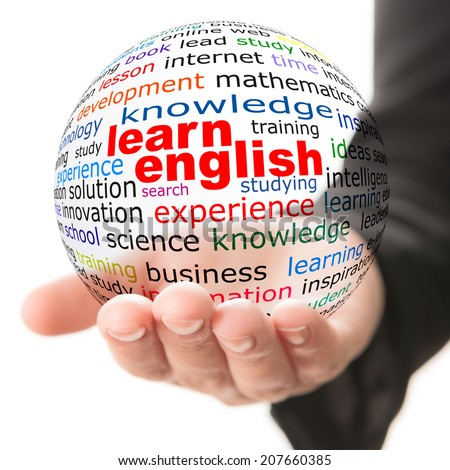 Transparent ball with inscription learn English in a hand - stock photo