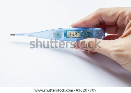 transparent blue digital normal temperature 33.9 Celsius in hand on white background