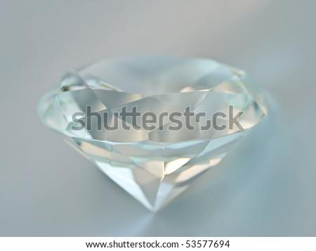 Transparent blue tinted round gemstone - stock photo