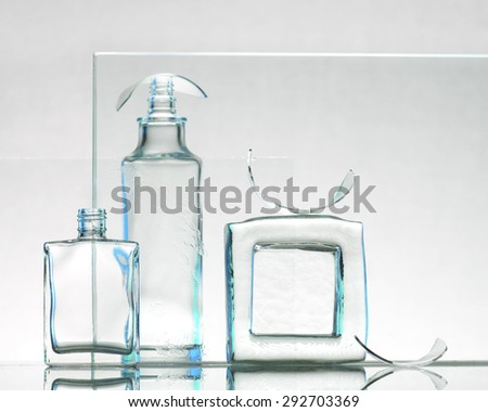 Transparent bottles on the light background - stock photo