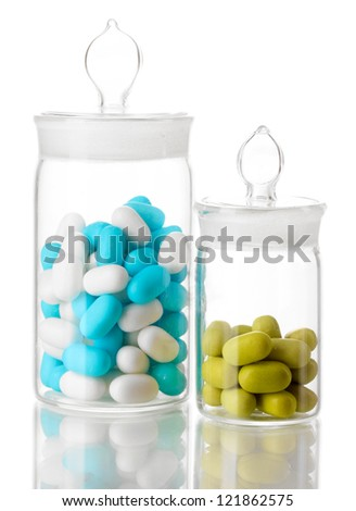 Transparent bottles with pills isolated on white - stock photo