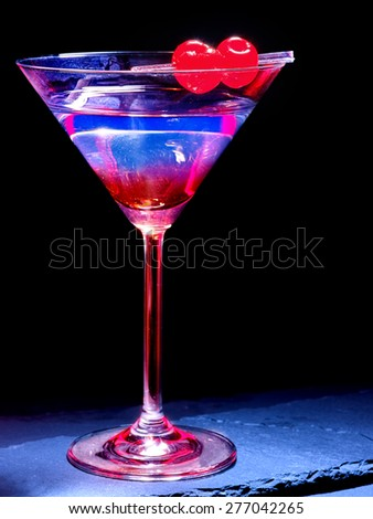 Transparent cherry cocktail on black background. Cocktail card 49 - stock photo