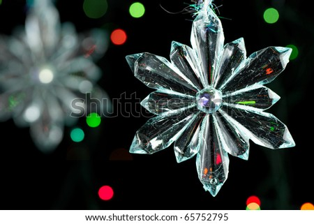 Transparent christmas snowflake on the black background - stock photo