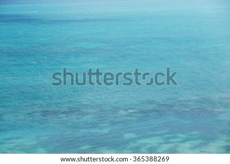 Transparent clear blue sea - stock photo