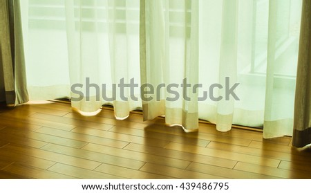 Transparent curtain on window. Curtain background.