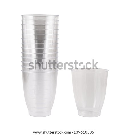 Transparent disposable plastic cups, single and pile stack, isolated over white background - stock photo