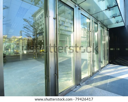 Transparent door of modern building - stock photo