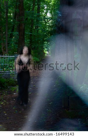 Transparent Ghost running too fast to capture in cemetery - stock photo