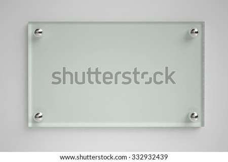 Transparent glass board on the wall - stock photo