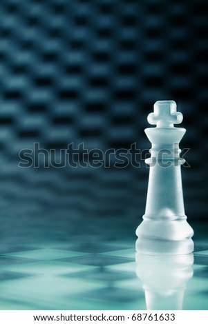 transparent glass chess king on chessboard - stock photo
