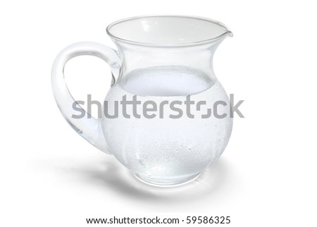 Transparent glass jar with cold water - stock photo